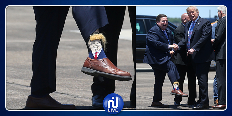 """حاكم لويزيانا يستقبل الرئيس الأمريكى بـ """"جورب"""" على شكل ترامب (صور)"""