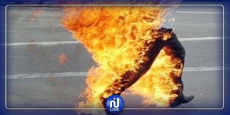 الدهماني : شاب يضرم النار فى جسده