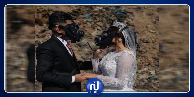 جلسة تصوير لعروسين في مصب القمامة (صور)