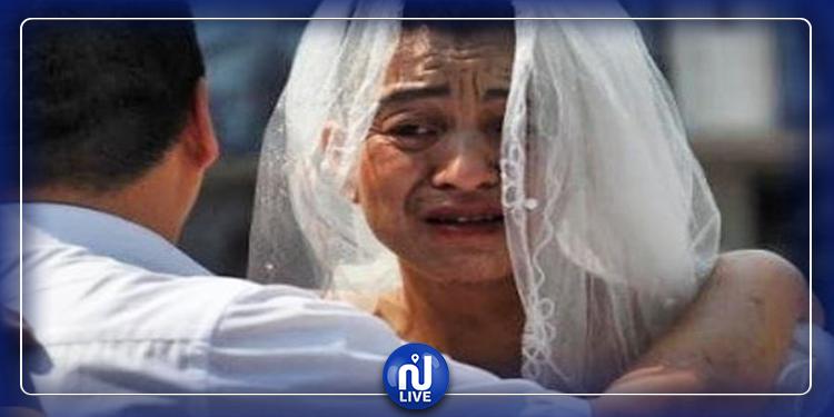 أب يرتدي فستان زفاف ويضع أحمر شفاه لإنقاذ ابنته! (صور)