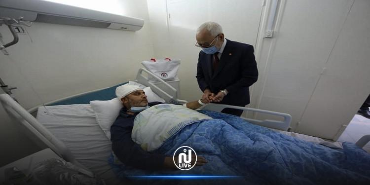 راشد الغنّوشي يعُود النائب أحمد موحى بالمستشفى العسكري